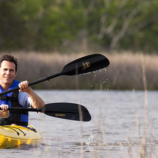Family Kayaking in River
