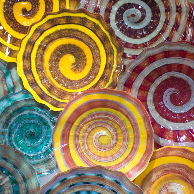 Bright colored blown glass on wall