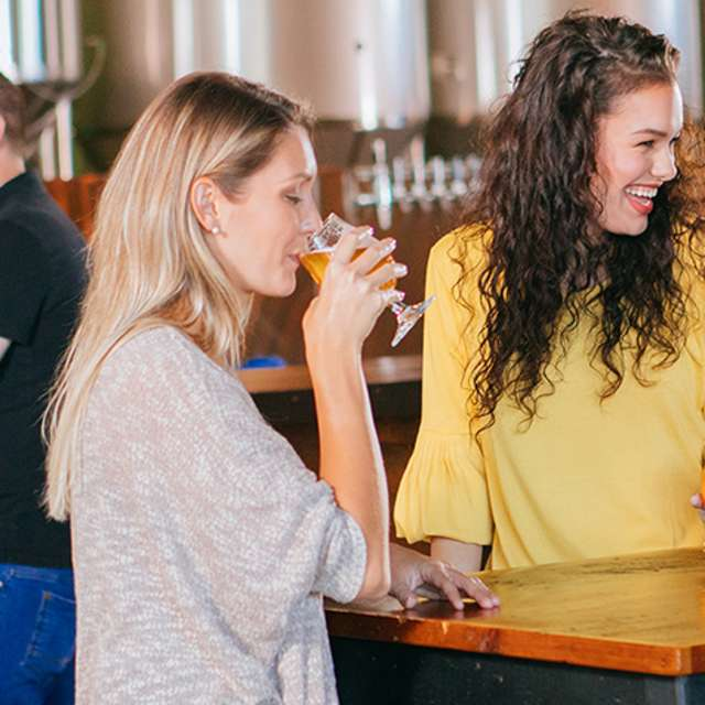 Friends chat over beers at Ever Grain Brewing Co. in Camp Hill, PA in the Cumberland Valley
