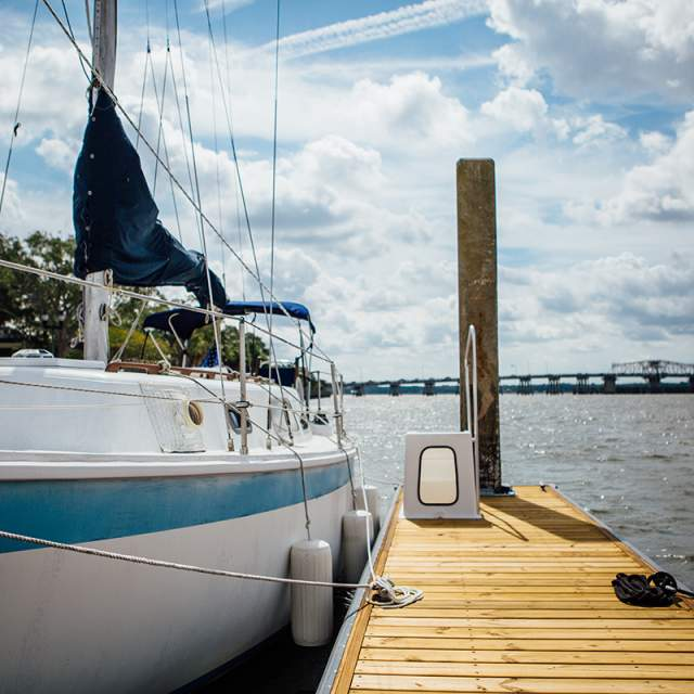 Sailboat by a dock