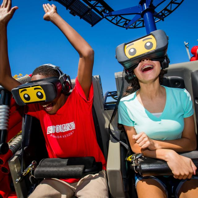 Riders wearing VR headsets enjoy The Great Lego Race at LEGOLAND Florida Resort
