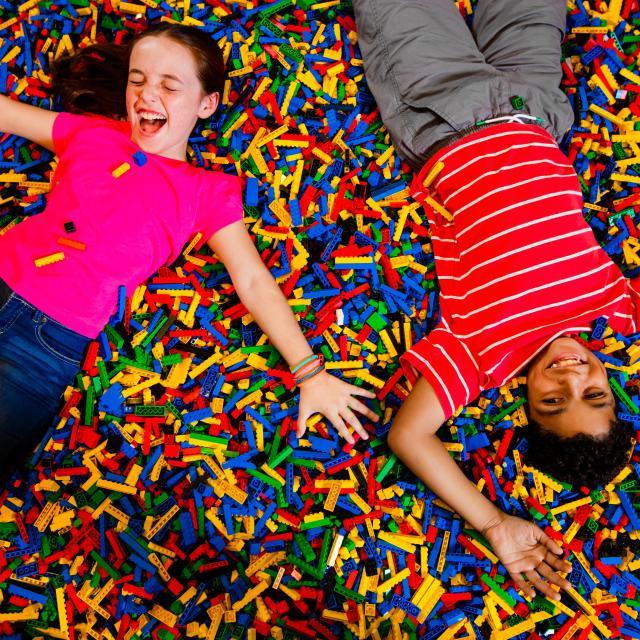 LEGOLAND® Florida Resort kids on bed of legos