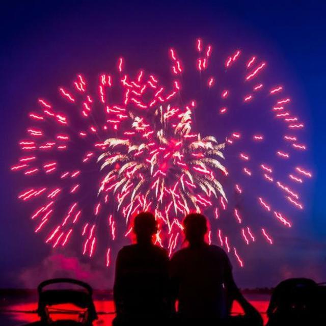 Families watch a firework display at LEGOLAND Florida Resort.