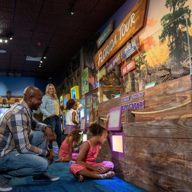 A family tours an exhibit at Ripley's Believe It or Not! Orlando.
