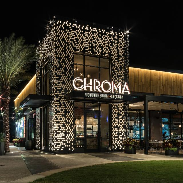 Chroma Modern Bar + Kitchen exterior at night