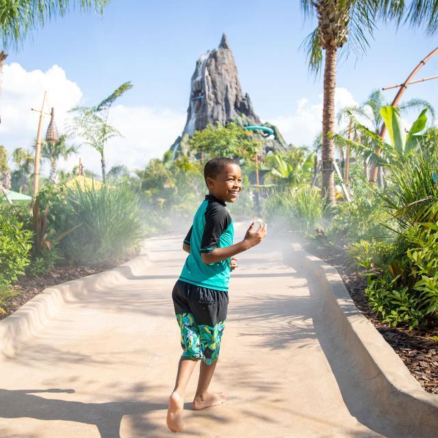 Universal's Volcano Bay™ Honu Ika Moana walkway boy