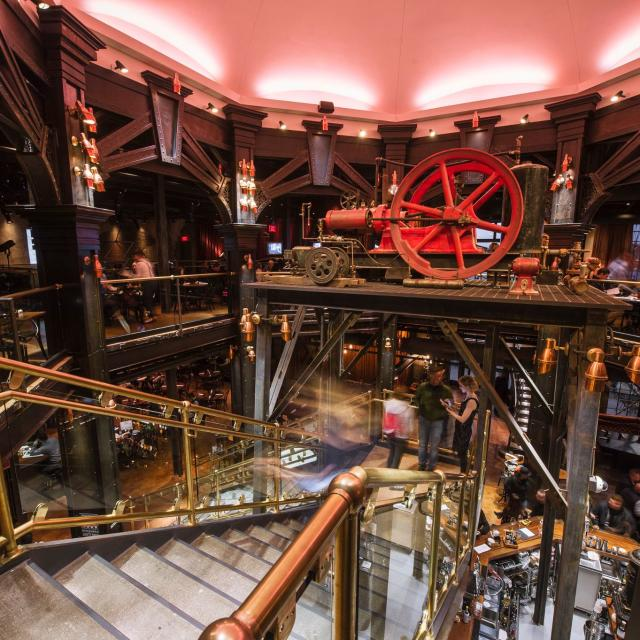 """The Edison at Disney Springs is a lavish, """"Industrial Gothic""""-style restaurant, bar and nighttime destination. It is themed to a 1920s-period power plant, recalling an exuberant era of invention and imagination and features classic American food, craft cocktails and live entertainment including cabaret and music."""