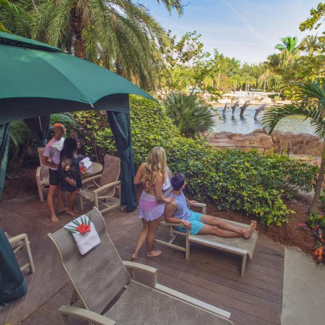 Couples sitting at their cabana in Discovery Cove®