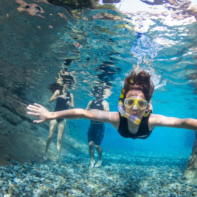 A woman snorkeling at Discovery Cove Wind-Away River
