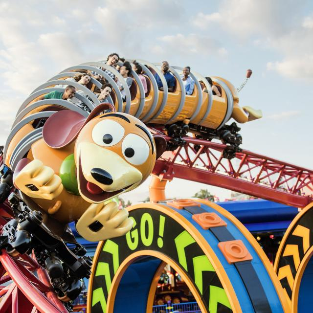Guests riding the Slinky Dog Dash ride at Disney's Hollywood Studios during the day