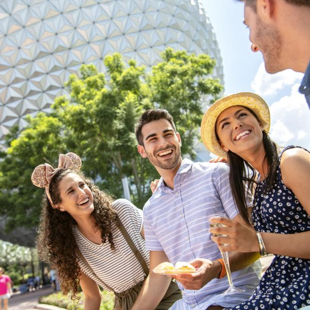 Two couples enjoying the Epcot International Food & Wine Festival