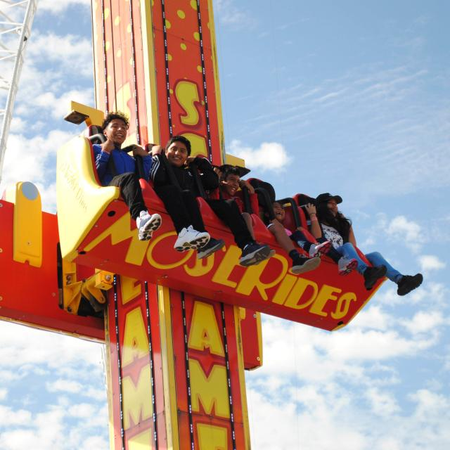 A family enjoys a drop ride at Fun Spot America, one of many attractions in Orlando, Florida.