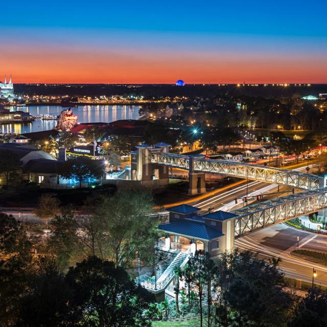 The pedestrian bridge from Hilton Orlando Lake Buena Vista to Disney Springs at night