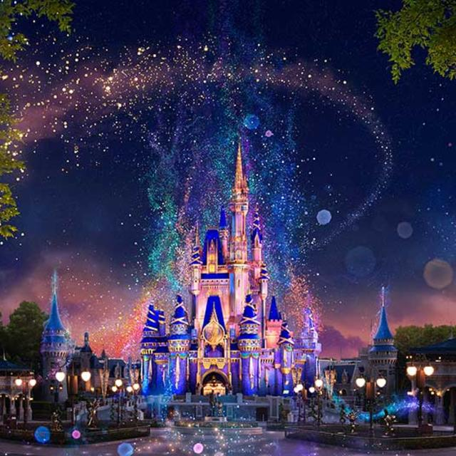 Walt Disney World Magic Kingdom Park Cinderella's castle surrounded by fairy dust