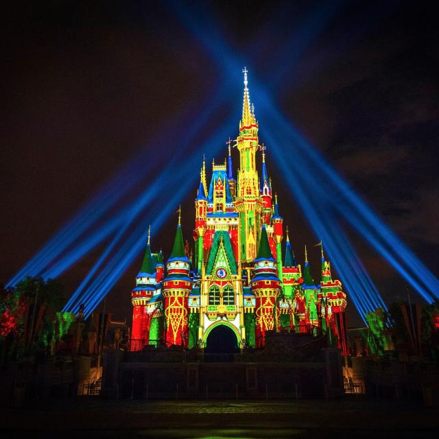 Cinderella's Castle at Magic Kingdom Park at Walt Disney World Resort lights up for the Holidays