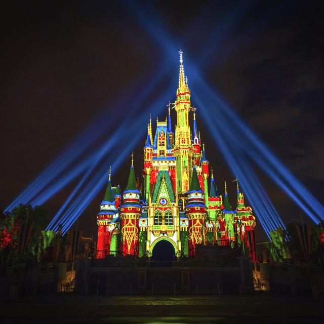 Cinderella's Castle at Magic Kingdom Park at Walt Disney World Resort lights up for the Holidays