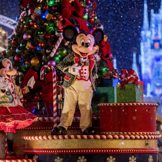 """The enchanting holiday parade during Mickey's Very Merry Christmas Party at Magic Kingdom Park transforms Main Street, U.S.A. Santa Claus, gingerbread men, elves, reindeer, toy soldiers and other friends from the North Pole join Mickey Mouse and his pals. Anna, Elsa, Kristoff and Olaf from """"Frozen"""" join in the fun. (Kent Phillips, photographer)"""