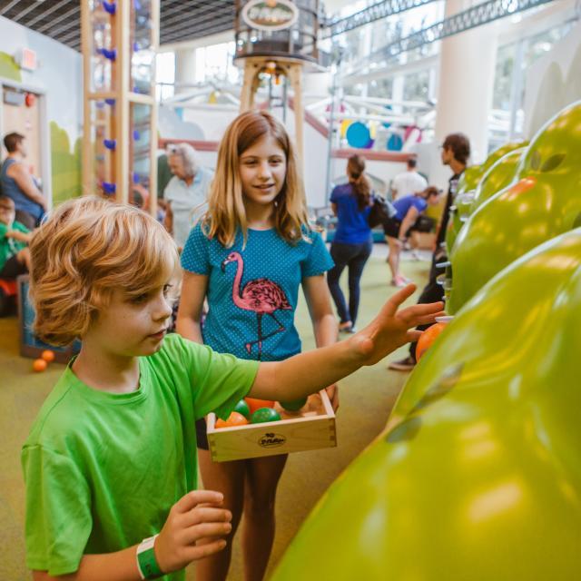 Orlando Science Center children with imaginary orange grove