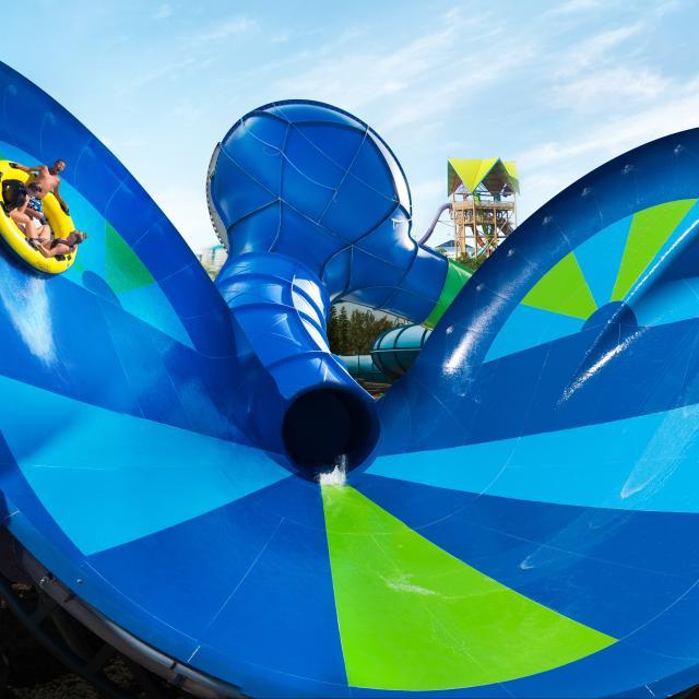 A family riding a tube on Ray Rush at Aquatica Orlando