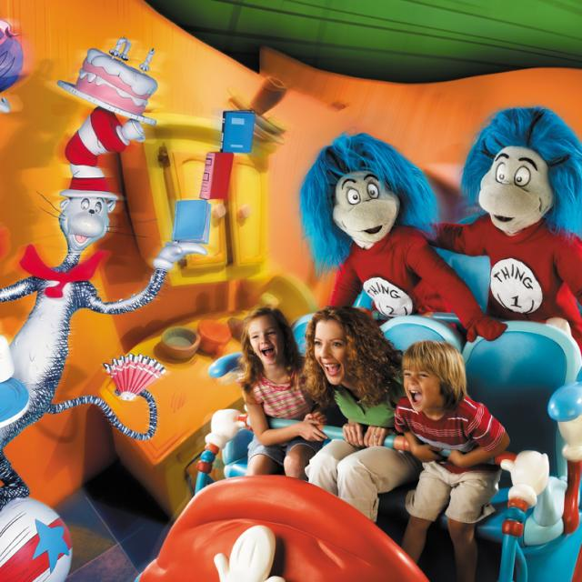 Thing 1 and Thing 2 accompany a mother and her two children as they  enjoy a wild ride on the Dr. Seuss Cat in the Hat attraction at Universal's Islands of Adventure