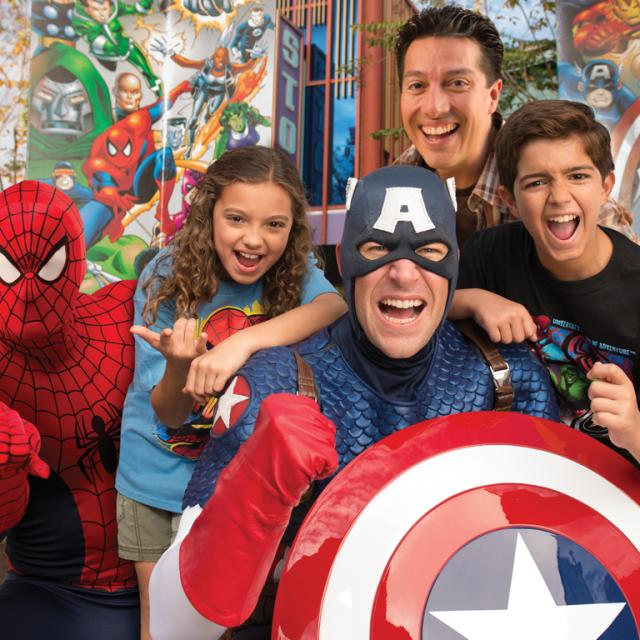 Spiderman and Captain American pose with a family at Universal's Islands of Adventure