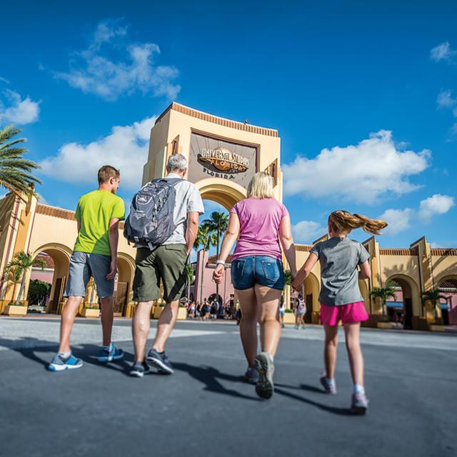 Universal Studios Florida family walking towards arch