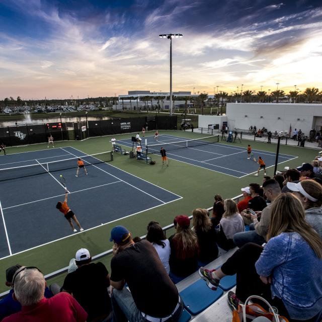 A crowd watches a tennis match at USTA National Campus Collegiate Center.