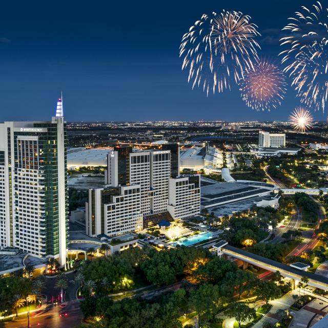 Drone footage of Hyatt Regency Orlando with fireworks in the background