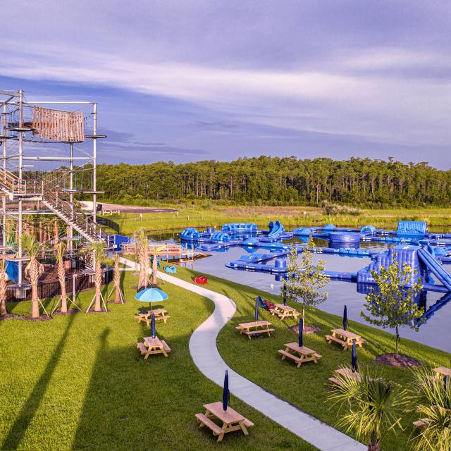 Two outdoor obstacle courses on and near the lake at Nona Adventure Park in Lake Nona.