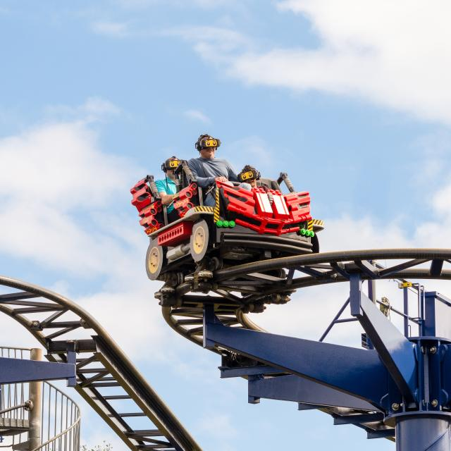 A LEGO car races around a turn in The Great Lego Race at LEGOLAND® Florida Resort