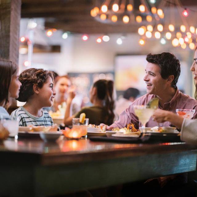 A family of four dining at Uncle Julio's at ICON Park