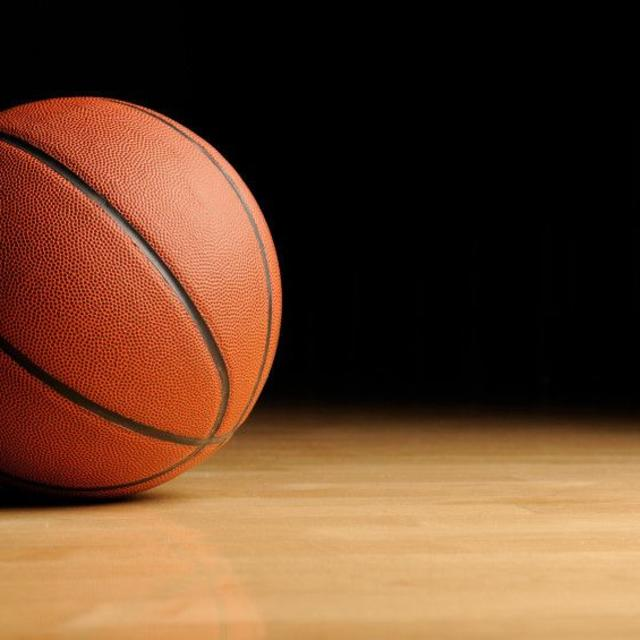 a basketball laying on the court
