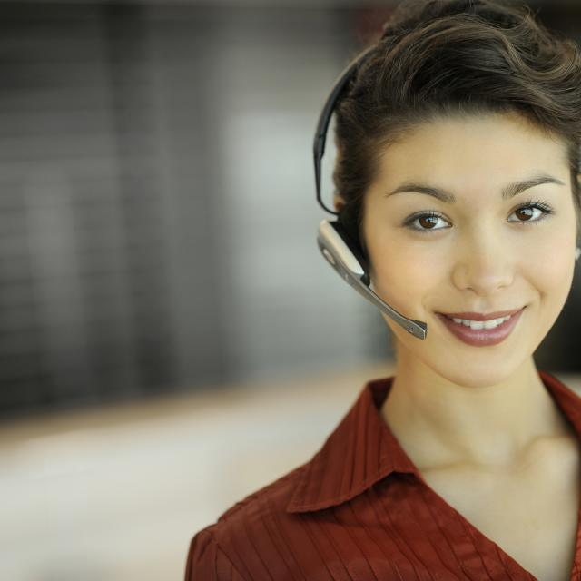 A young businesswoman wearing a headset