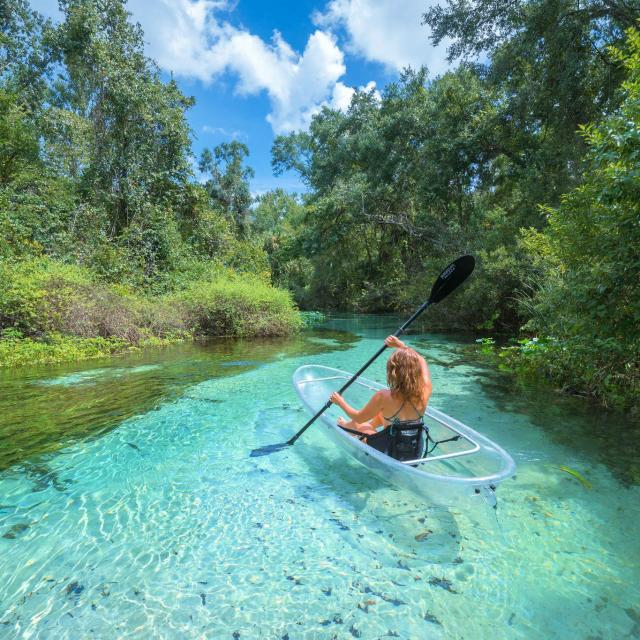 Bella Bucchiotti xoxoBella travel blogger on a clear kayak