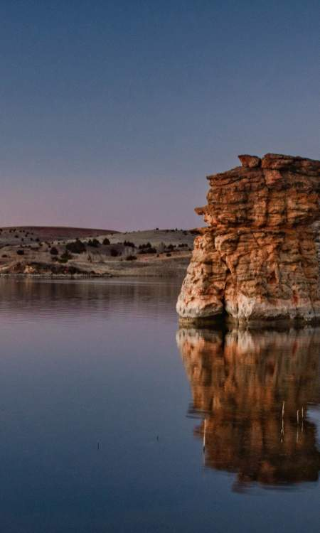 Calm waters of Wilson Lake and rock formations in Kansas