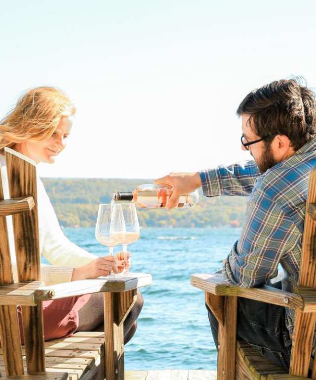 Couple on a Dock with Wine