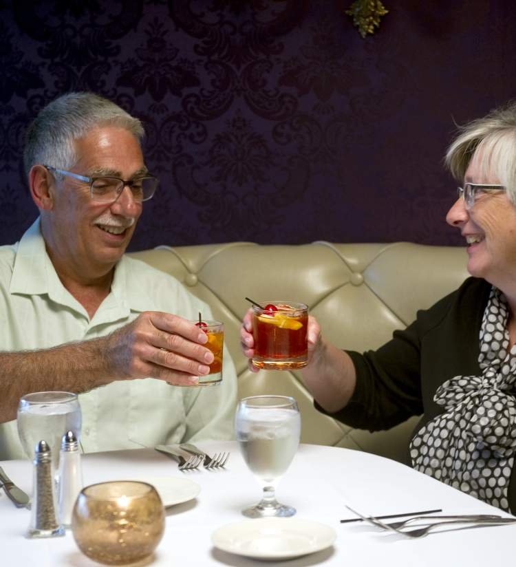 Couple with cocktails at Hobnob