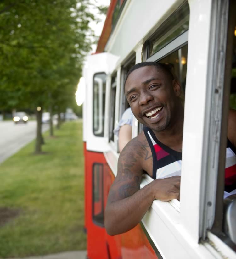 Man in the Window of a streetcar