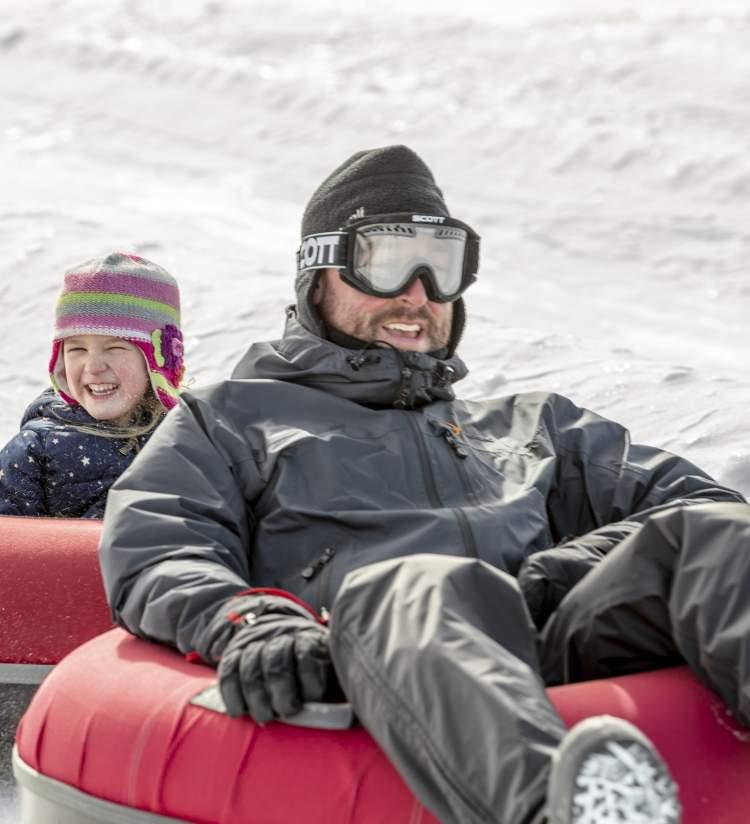 Dad & Daughter snowtubing