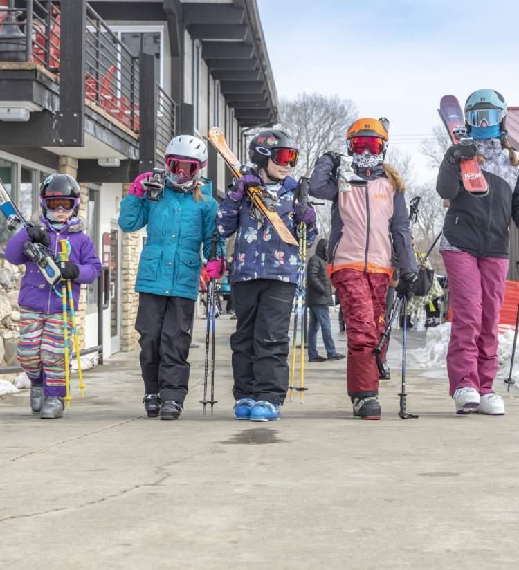 Kids in skiing gear