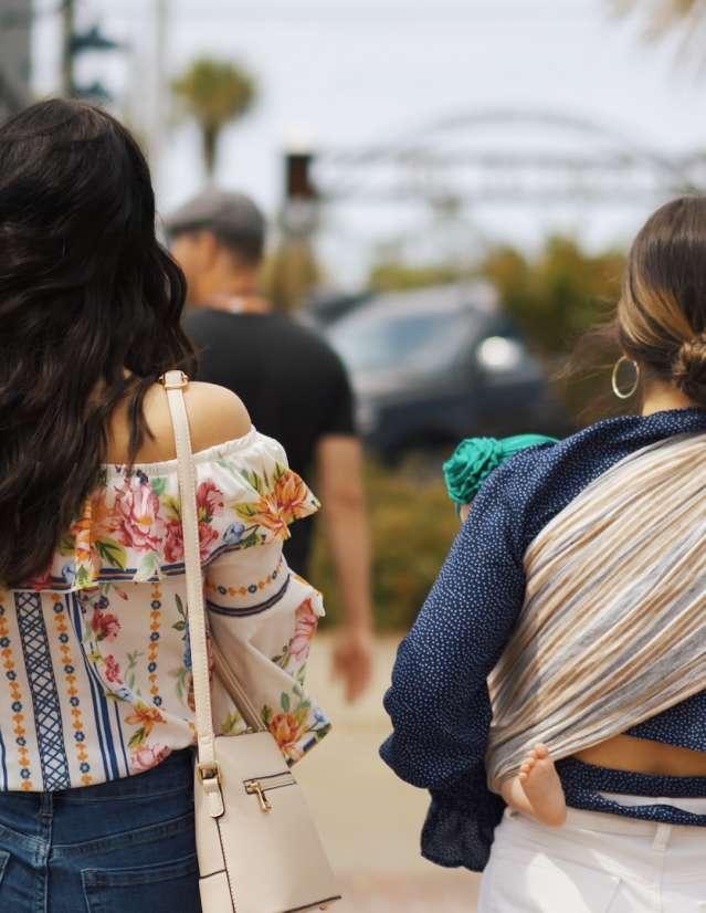two girls are walking down Reid Avenue in Port St. Joe