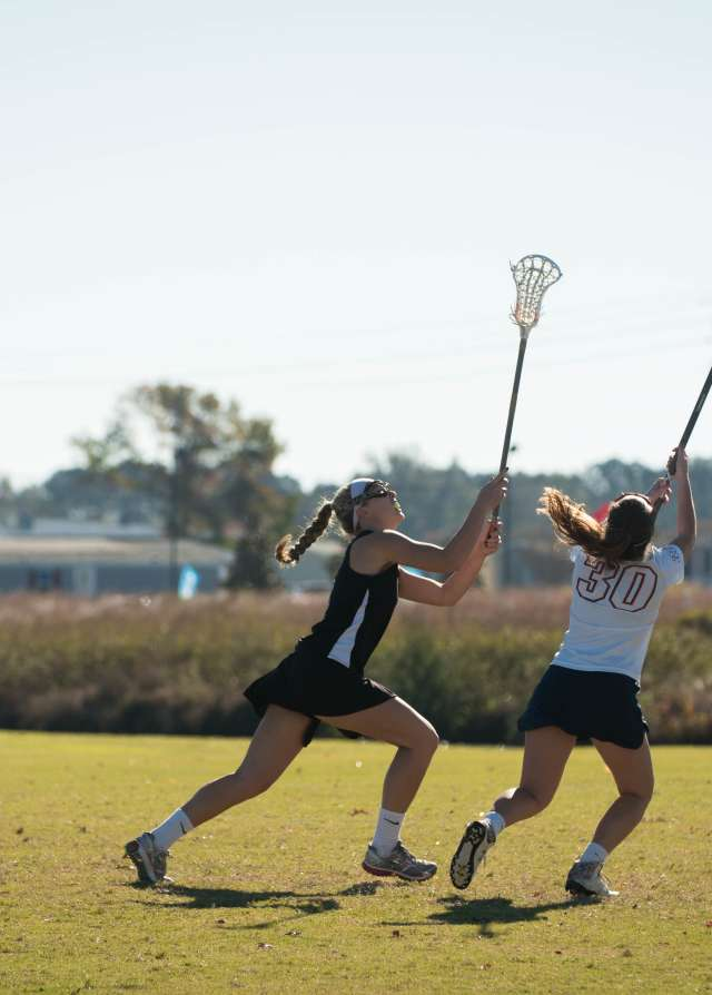 Women Playing Lacrosse