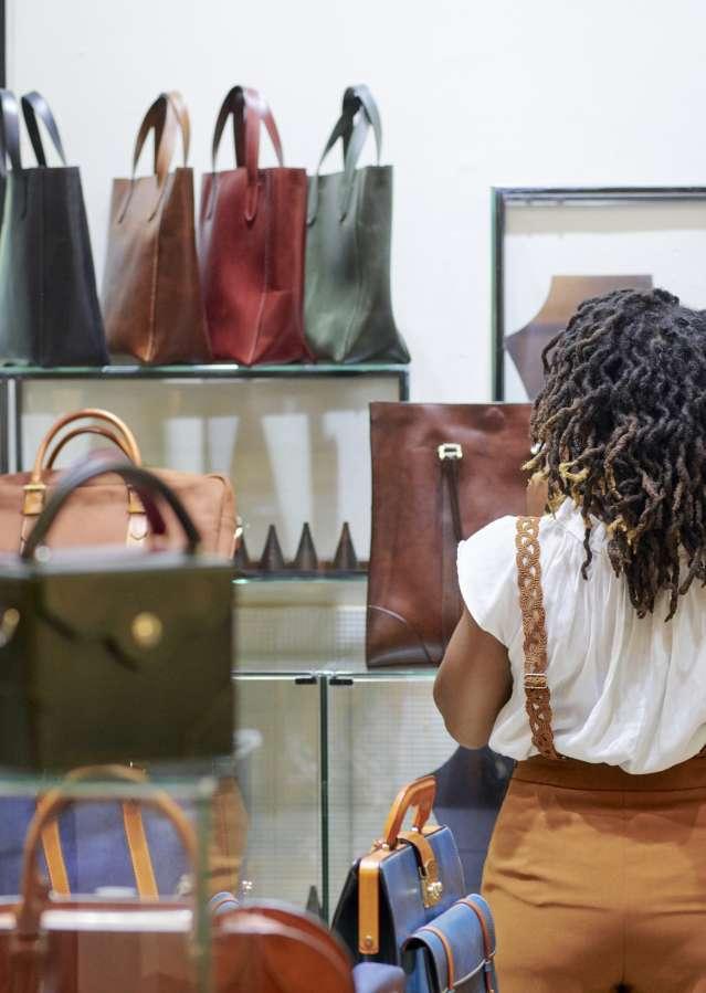 Shopper in a boutique handbag shop