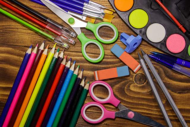 Colorful art supplies laid out on a table
