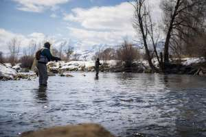 Two men casting fly fishing line in Provo River