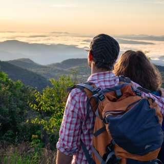 A couple enjoys a mountain vista near Asheville, NC