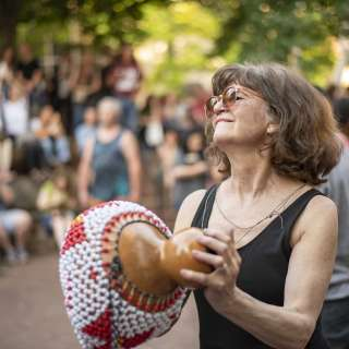 Woman dancing at drum circle in Asheville, N.C.