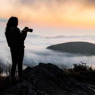A photographer at sunset along the Blue Ridge Parkway near Asheville, NC