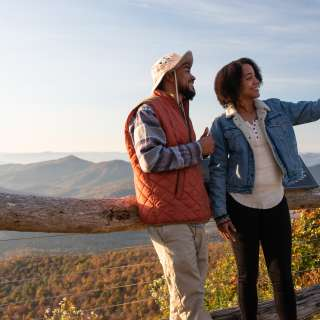 Two visitors take a selfie on the Blue Ridge Parkway near Asheville, NC