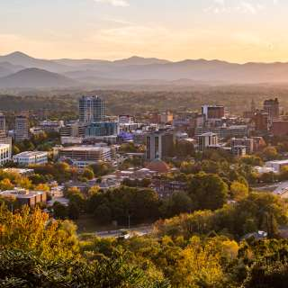 The city of Asheville is set against the backdrop of the beautiful Blue Ridge Mountains
